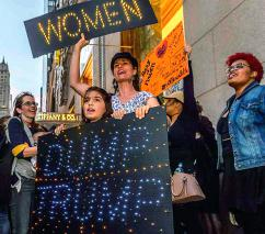 Women march in midtown Manhattan against Trump's sexism and bigotry