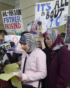 Leena Al-Arian reads a letter written by her father at a February 2003 protest (Grant Jefferies | KRT)