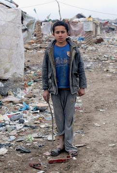 An internally displaced refugee living in a camp outside Baghdad that was built on a garbage dump