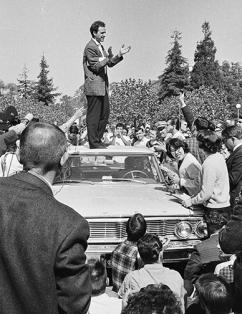 Mario Savio speaks to protesters at UC Berkeley as students blockade a police car (Steven Marcus)