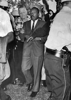 Martin Luther King marches into Chicago's Marquette Park, shortly before he was struck by debris thrown by racist counterdemonstrators