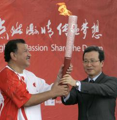 The Olympic torch in Malaysia, during its journey to the Beijing Games (Tengku Bahar   AFP)