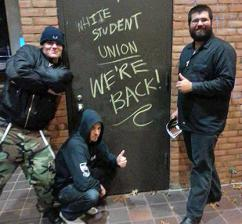 White supremacists, led by Matthew Heimbach (right) vandalize the Towson University campus