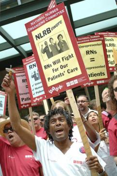 Nurses from the National Nurses Organizing Committee at a protest to defend union rights for RNs (NNOC | NNOC)