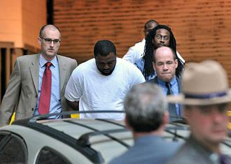 James Cromitie and David Williams being escorted to their arraignment in May