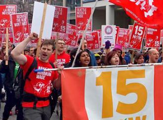 Seattle supporters of a $15 minimum wage on the march (15Now.org)