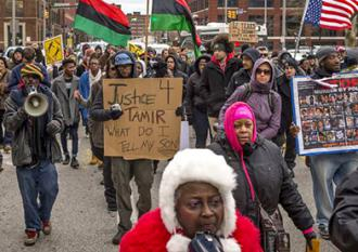 Protesters march for Tamir Rice after a grand jury refused to indict the cop who killed him