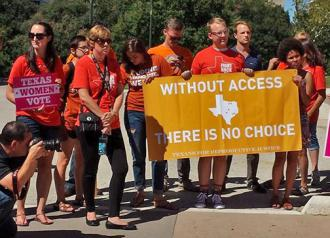 Supporters of abortion rights rally at the Texas Capitol building in Austin (Dana Cloud | SW)
