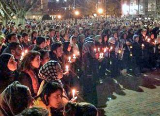A vigil in Chapel Hill for the three murdered Muslim students (Our Three Winners)