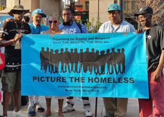 Picture the Homeless taking action earlier this summer (Picture the Homeless)