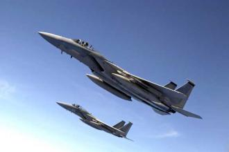Two F-15 Eagle fighter jets perform a training exercise  (Miranda Moorer)