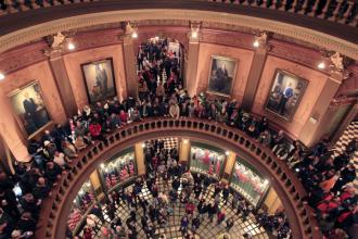 "Protesters fill the Michigan Capitol building to protest ""right-to-work"" legislation"