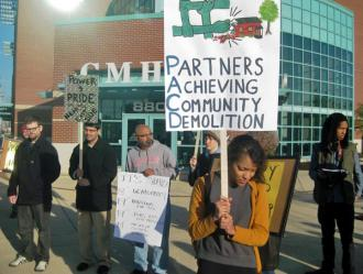 Poindexter supporters and activists protest outside Columbus Metropolitan Housing Authority
