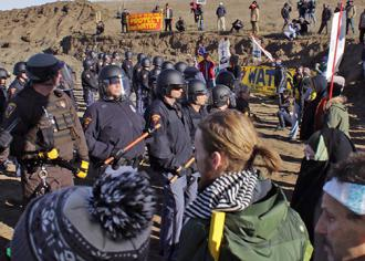 North Dakota riot police move in to make mass arrests at       Standing Rock (Red Warrior Camp)