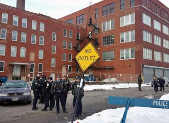 "Chicago police stand outside their Homan Square ""black site"" (Brian Greene)"