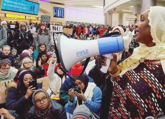 Over a thousand protesters sit in at Columbus International Airport to resist Trump's ban on Muslims (Ohio Interfaith Immigrant and Migrant Justice Coalition)