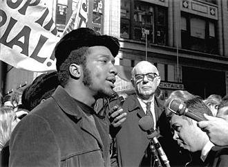 Chicago Black Panther leader Fred Hampton speaks to reporters