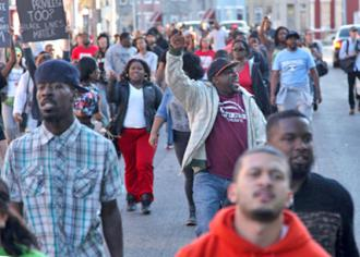 Baltimore residents on the march to demand justice for Freddie Gray (Arash Azizzada)