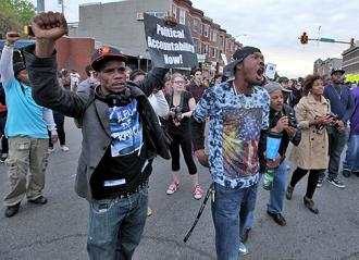 Baltimore celebrates charges against the six officers involved in Freddie Gray's murder (James Cullum)