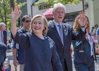 Hillary Clinton on the campaign trail, with Bill Clinton accompanying her (Barbara Kinney)