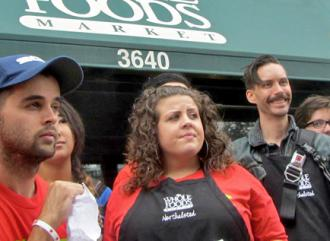 Rhiannon Broschat-Salguero (center) at a protest alongside coworkers and supporters