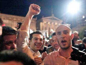SYRIZA leader Alexis Tsipras (with fist raised) celebrates with supporters on election night