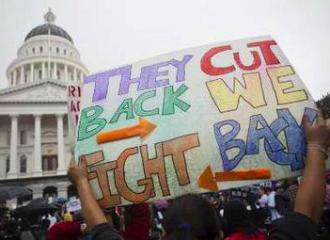 Demonstrating against education cuts outside the Capitol building in Sacramento