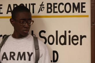 A new recruit to the Army waits in line during the intake process (Staff Sgt. Manuel J. Martinez)