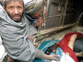 Survivors mourn the deaths of civilians following the massacre in Kandahar