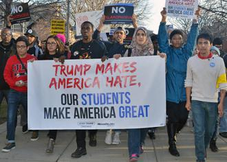 UIC students lead a march against Trump's rally in Chicago (Christine Geovanis)