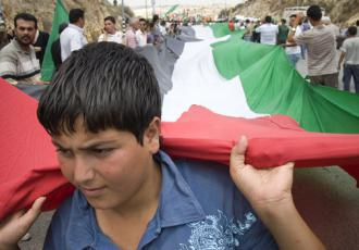A boy leads a protest in the village of Ni'lin in the West Bank