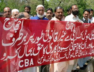 Workers protest outside the Pearl Continental Hotel near Islamabad