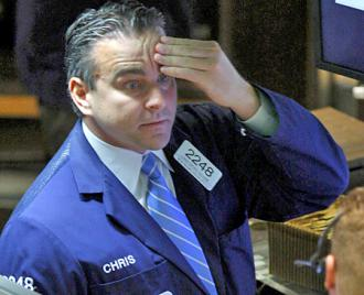 A trader at the New York Stock Exchange watches as the markets plunge