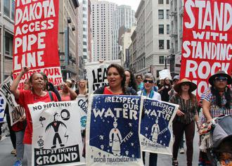 Opponents of the Dakota Access Pipeline march through downtown San Francisco  (Peg Hunter)