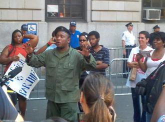 Supporters of anti-police brutality activist Jazz Hayden listen to a speaker outside the 32nd Precinct (Yoni Golijov | SW)
