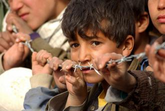 An Afghan boy from the village of Aroki (Staff Sgt. Cherie A. Thurlby)