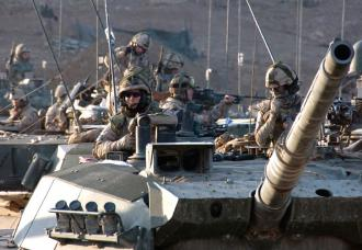 Tank crews in Afghanistan wait for the order to move out (Edward Stewart)