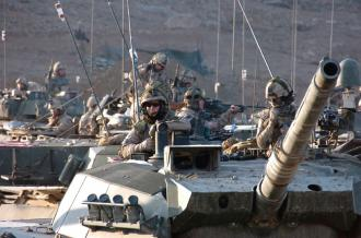 U.S. tank crews move toward a Forward Operating Base near Kandahar in Afghanistan (Edward Stewart)