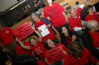 Los Angeles teachers sit in at a school board meeting to protest planned layoffs (Kim Turner | UTLA)