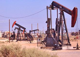 Oil derricks cover the landscape in California