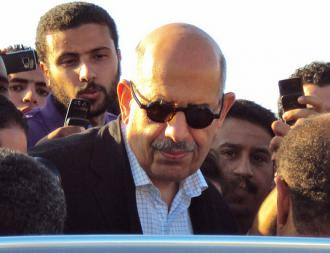 Mohamed ElBaradei surrounded by reporters in Cairo