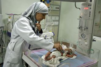 An infant receives treatment in a hospital in Falluja, Iraq (Laura Epatko)