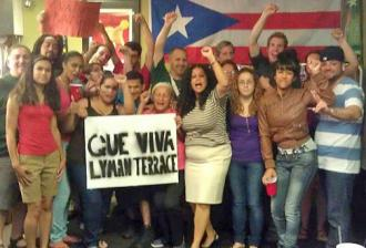 Residents of Lyman Terrace celebrate the mayor's retreat on demolishing their housing project (Que Viva Lyman Terrace)