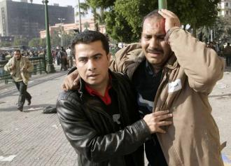 A protester wounded by pro-Mubarak thugs who charged the crowds in Tahrir Square (Nasser Nouri)