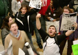 Workers and students fill the Capitol building in Madison protesting Wisconsin Gov. Scott Walker's attacks on unions (Jessie Reeder)