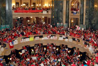 Workers and students filled the Wisconsin capitol building for another day of protest against Gov. Scott Walker's anti-labor bill (Peter Gorman)
