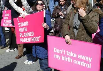 Demonstrating against the right wing's attack on Planned Parenthood