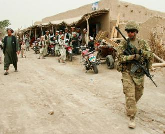 A U.S. soldier patrols a village bazaar in Northern Balkh Province in Afghanistan