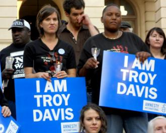 Supporters at a vigil stand in solidarity with Troy Davis
