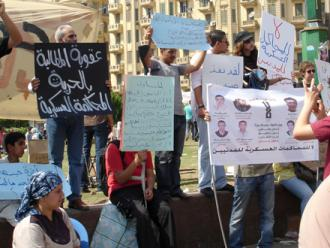 Protesters in Tahrir Square demand an end to the use of military trials against civilians (Zeinab Mohamed)